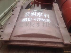 聚财牌铸铁镶铜闸门应用